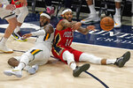 New Orleans Pelicans forward Brandon Ingram (14) passes the ball after fighting for a loose ball with Utah Jazz forward Royce O'Neale, left, during the second half of an NBA basketball game Thursday, Jan. 21, 2021, in Salt Lake City. (AP Photo/Rick Bowmer)