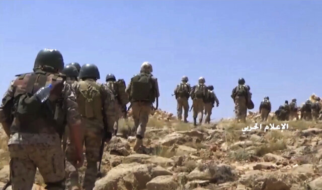 FILE - This file frame grab from video released on July 22, 2017 and provided by the government-controlled Syrian Central Military Media, shows Hezbollah fighters advancing up a hill during clashes with al-Qaida-linked militants in an area on the Lebanon-Syria border. Lebanon's militant Hezbollah group lost at least eight fighters in northwestern Syria in fighting against insurgents and airstrikes by the Turkey's air force following the death of at least 33 Turkish soldiers earlier this week, a Syrian opposition war monitor and the militant group said Saturday. (Syrian Central Military Media, via AP, File)