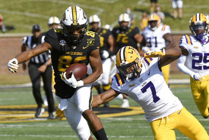 Missouri wide receiver Tauskie Dove, left, catches a touchdown pass as LSU safety JaCoby Stevens (7) defends during the first half of an NCAA college football game Saturday, Oct. 10, 2020, in Columbia, Mo. (AP Photo/L.G. Patterson)