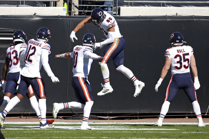 Chicago Bears tight end Jimmy Graham, second from right, celebrates his touchdown catch against the Jacksonville Jaguars with teammates Javon Wims (83), Allen Robinson II (12), quarterback Mitchell Trubisky (10) and Ryan Nall (35) during the first half of an NFL football game, Sunday, Dec. 27, 2020, in Jacksonville, Fla. (AP Photo/Stephen B. Morton)
