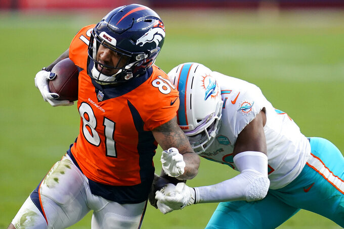 Denver Broncos wide receiver Tim Patrick (81) is hit by Miami Dolphins free safety Eric Rowe during the second half of an NFL football game, Sunday, Nov. 22, 2020, in Denver. (AP Photo/David Zalubowski)
