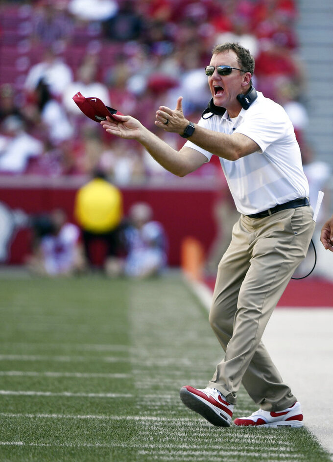 Arkansas coach Chad Morris reacts to a call  in the first half of an NCAA college football game against North Texas, Saturday, Sept. 15, 2018, in Fayetteville, Ark. (AP Photo/Michael Woods)