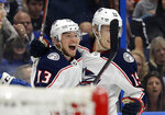 Columbus Blue Jackets right wing Cam Atkinson (13) celebrates his goal against the Tampa Bay Lightning with center Ryan Dzingel (19) during the first period of Game 2 of an NHL Eastern Conference first-round hockey playoff series Friday, April 12, 2019, in Tampa, Fla. (AP Photo/Chris O'Meara)