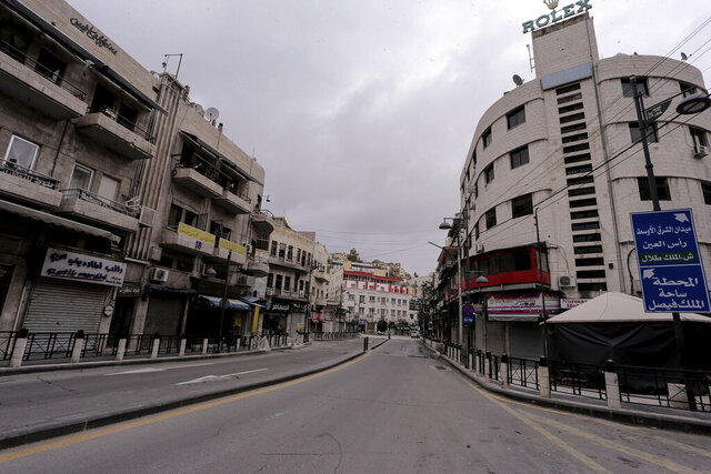 The streets of the Jordanian Capital are seen empty after the start of a nationwide curfew, amid concerns over the coronavirus pandemic, in Amman, Jordan,Saturday, March 21, 2020.  Air raid sirens have echoed across Jordan's capital to mark the start of a three-day curfew. It's the latest mass lockdown in the Middle East aimed at containing the coronavirus (AP Photo/Raad Adayleh)