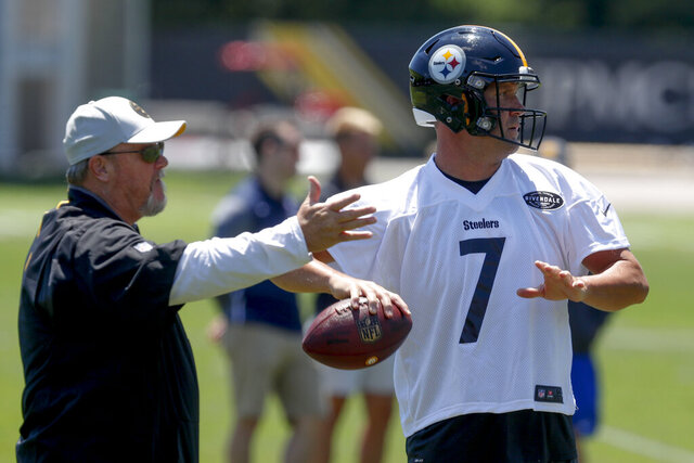 FILE - In this June 11, 2019, file photo, Pittsburgh Steelers quarterback Ben Roethlisberger (7) throws as offensive coordinator Randy Fichtner watches during NFL football practice in Pittsburgh. Fichtner has a message for players who think everything will be easy now that star quarterback Ben Roethlisberger has returned from an elbow injury that limited him to two games in 2019.