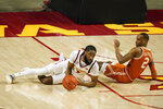 Iowa State guard Tre Jackson, left, fights for a loose ball with Texas guard Matt Coleman III, right, during the first half of an NCAA college basketball game, Tuesday, March 2, 2021, in Ames, Iowa. (AP Photo/Charlie Neibergall)