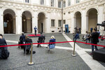 Italian Premier Giuseppe Conte announces new rules to curb the spread of COVID-19, in Rome, Sunday, Oct. 25, 2020. For at least the next month, people outdoors except for small children must now wear masks in all of Italy, gyms, cinemas and movie theaters will be closed, ski slopes are off-limits to all but competitive skiers and cafes and restaurants must shut down in early evenings, under a decree signed on Sunday by Italian Premier Giuseppe Conte, who ruled against another severe lockdown despite a current surge in COVID-19 infections. (Roberto Monaldo/LaPresse via AP)