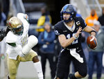 Middle Tennessee quarterback Brent Stockstill (12) scrambles from UAB linebacker Tre' Crawford (15) during the second half of the Conference USA championship NCAA college football game Saturday, Dec. 1, 2018, in Murfreesboro, Tenn. UAB won 27-25. (AP Photo/Mark Humphrey)