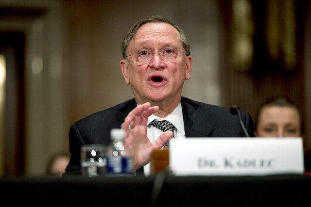 "FILE - In this March 3, 2020 file photo, Health and Human Services Assistant Secretary for Preparedness and Response Dr. Robert Kadlec testifies before a Senate Education, Labor and Pensions Committee hearing on the coronavirus on Capitol Hill in Washington. Kadlec said in an email Friday, Oct. 9, that the Trump administration ""is accelerating production of safe and effective vaccines ... to ensure delivery starting January 2021."