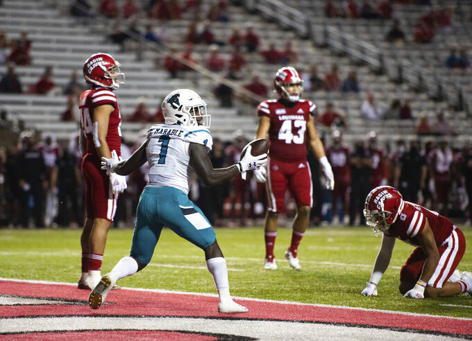 Coastal Carolina running back CJ Marable (1) searches for an official's signal after scoring a touchdown during the first half of an NCAA football game against Louisiana-Lafayette in Lafayette, La., Wednesday, Oct. 14, 2020. (AP Photo/Paul Kieu)