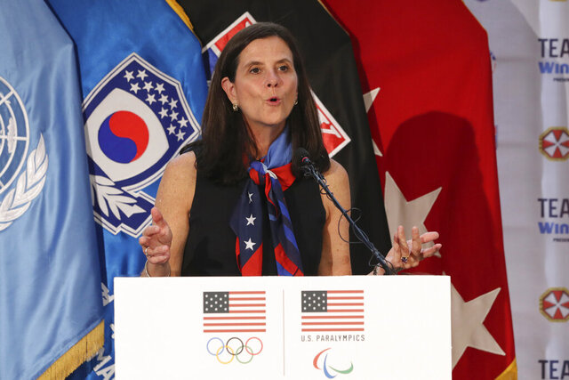 FILE - In this Aug. 1, 2017, file photo, then-U.S. Olympic Committee chief marketing officer Lisa Baird speaks about the Team USA WinterFest for the upcoming 2018 Pyeongchang Winter Olympic Games, at Yongsan Garrison, a U.S. military base in Seoul, South Korea. Baird assumed her new role as commissioner of the National Women's Soccer League on March 10. Two days later, she shut down the league because of coronavirus. It's certainly not the way she imagined her first 48 hours on the job would go. (AP Photo/Lee Jin-man, File)