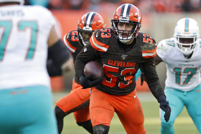 Cleveland Browns middle linebacker Joe Schobert (53) returns an interception during the second half of an NFL football game against the Miami Dolphins, Sunday, Nov. 24, 2019, in Cleveland. (AP Photo/Ron Schwane)