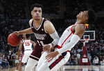 Mississippi State guard Quinndary Weatherspoon, left, knocks Mississippi guard Breein Tyree, right, off balance as he dribbles around him in the first half of an NCAA college basketball game, Saturday, Jan. 12, 2019 in Starkville, Miss. (AP Photo/Rogelio V. Solis)
