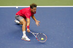 Dominic Thiem, of Austria, returns a shot to Alexander Zverev, of Germany, during the men's singles final of the US Open tennis championships, Sunday, Sept. 13, 2020, in New York. (AP Photo/Seth Wenig)