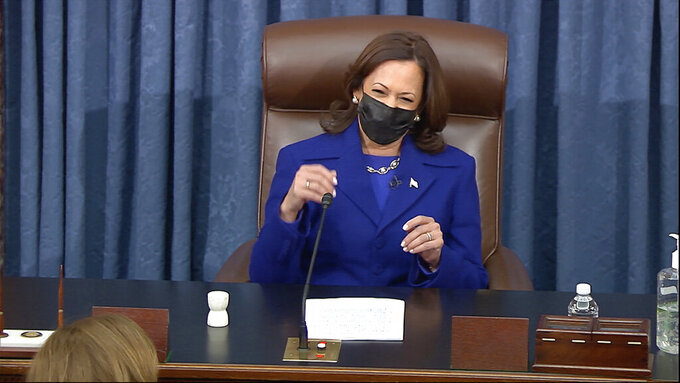 In this image from video, Vice President Kamala Harris presides over the Senate Wednesday, Jan. 6, 2021, on Capitol Hill in Washington. (Senate Television via AP)