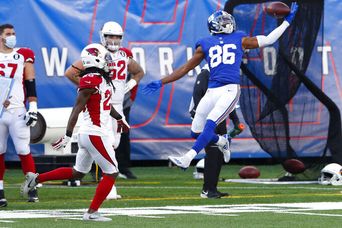 New York Giants' Darius Slayton (86), right, can't make the catch during the first half of an NFL football game against the Arizona Cardinals, Sunday, Dec. 13, 2020, in East Rutherford, N.J. (AP Photo/Noah K. Murray)