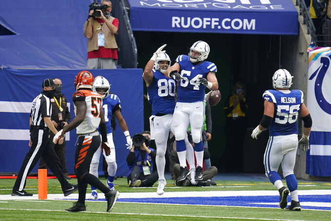 Indianapolis Colts' Trey Burton (80) celebrates a touchdown reception with Mark Glowinski (64) during the first half of an NFL football game against the Cincinnati Bengals, Sunday, Oct. 18, 2020, in Indianapolis. (AP Photo/Michael Conroy)