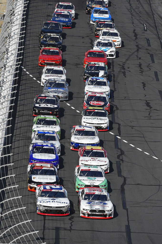 Chase Briscoe (98) and Tyler Reddick (2) lead the field to the start of the NASCAR Xfinity Series auto race at Charlotte Motor Speedway, Saturday, Sept. 28, 2019, in Concord, N.C. (AP Photo/Mike McCarn)