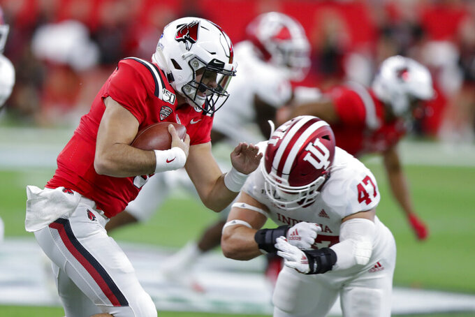 Ball State quarterback Drew Plitt (9) tries to get past Indiana linebacker Micah McFadden (47) during the first half of a college football game in Indianapolis, Saturday, Aug. 31, 2019. (AP Photo/Michael Conroy)