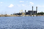 This Sept. 14, 2020 photo shows shows a Duke Energy natural gas-fired electric power plant on Sutton Lake in Wilmington, N.C. It went online in 2013 and replaced a coal-fired plant that had polluted the lake with coal ash. Sutton Lake is among a number of man-made reservoirs in the U.S. that environmentalists say will lose federal protection from pollution under a Trump administration revision of the Clean Water Act that took effect this year. (AP Photo/John Flesher)