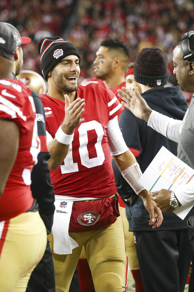San Francisco 49ers quarterback Jimmy Garoppolo (10) celebrates a win in the NFL NFC Championship football game against the Green Bay Packers, Sunday, Jan. 19, 2020 in Santa Clara, Calif. The 49ers defeated the Packers 37-20. (Margaret Bowles via AP)