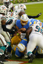Los Angeles Chargers quarterback Justin Herbert (10) scores a touchdown during the first half of an NFL football game against the Miami Dolphins, Sunday, Nov. 15, 2020, in Miami Gardens, Fla. (AP Photo/Lynne Sladky)