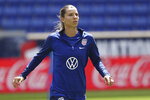 FILE - In this May 25, 2019, file photo, United States forward Tobin Heath warms up during a soccer workout at Red Bull Arena, in Harrison, N.J. U.S. national team players Megan Rapinoe, Tobin Heath and Christen Press have opted out of the National Women's Soccer League tournament kicking off this weekend in Utah. Heath and Press, who played with Rapinoe on the champion World Cup team last summer in France, cited concerns about the coronavirus for their decisions not to play.(AP Photo/Steve Luciano, File)