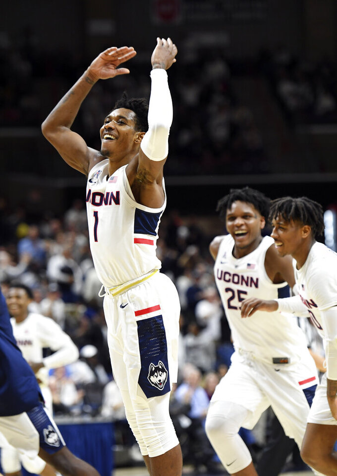Connecticut's Christian Vital (1) celebrates after making a long 3-point shot at the buzzer in the first half of the team's NCAA college basketball game against Wichita State on Saturday, Jan. 26, 2019, in Storrs, Conn. (AP Photo/Stephen Dunn)