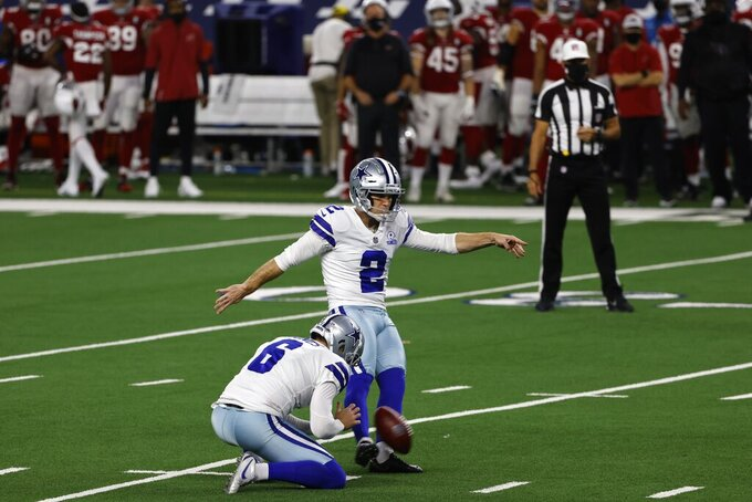 Dallas Cowboys' Chris Jones (6) holds as place kicker Greg Zuerlein (2) kicks a field goal in the first half of an NFL football game against the Arizona Cardinals in Arlington, Texas, Monday, Oct. 19, 2020. (AP Photo/Ron Jenkins)