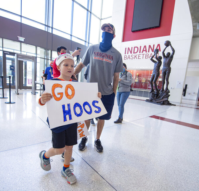 Fans begin arriving for the Virginia against Ohio first-round game in the NCAA men's college basketball tournament, Saturday, March 20, 2021, at Assembly Hall in Bloomington, Ind. (AP Photo/Doug McSchooler)