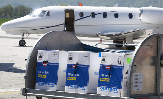 A container with boxes of the Pfizer vaccine delivered, at the Sarajevo Airport, Bosnia, Tuesday, May 4, 2021. The European Union has started delivering EU-funded coronavirus vaccines across the Balkans, where China and Russia have for months been supplying the much-needed shots and thus making political gains. (AP Photo/Eldar Emric)