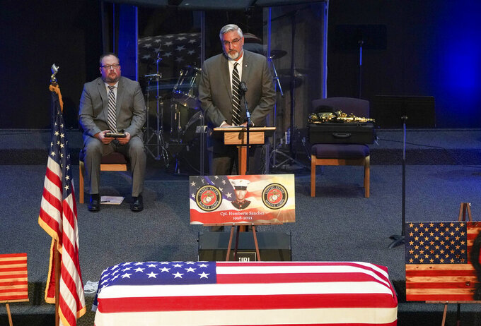 Gov. Eric Holcomb speaks to those attending the funeral service for Marine Cpl. Humberto Sanchez at LifeGate Church in Logansport, Ind., on Tuesday, Sept. 14, 2021. Sanchez was one of 13 U.S. service members killed in last month's suicide bombing at Afghanistan's Kabul airport during the U.S.-led evacuation.  (Jonah Hinebaugh/The Pharos-Tribune via AP)