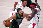 Boston Celtics' Jayson Tatum (0) drives against Toronto Raptors' Pascal Siakam during the second half of an NBA conference semifinal playoff basketball game Friday, Sept. 11, 2020, in Lake Buena Vista, Fla. (AP Photo/Mark J. Terrill)