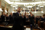 Lawmakers recognize dignitaries in the gallery before Kansas Gov. Laura Kelly's State of the State address Wednesday, Jan. 15, 2020, in Topeka, Kan. (AP Photo/Charlie Riedel)