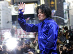 FILE - In this Nov. 7, 2001 file photo, Michael Jackson waves to crowds gathered to see him at his first ever in-store appearance to celebrate his new album
