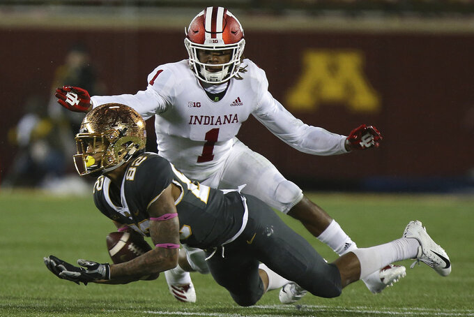 Minnesota wide receiver Demetrius Douglas tries to catch a ball as it slips through his arms against Indiana's Juwan Burgess during an NCAA college football game Friday, Oct. 26, 2018, in Minneapolis. Minnesota won 38-31. (AP Photo/Stacy Bengs)