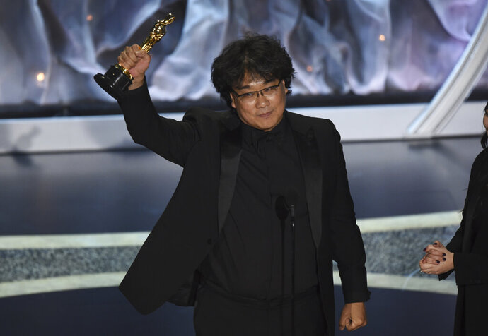 Bong Joon Ho accepts the award for best international feature film for