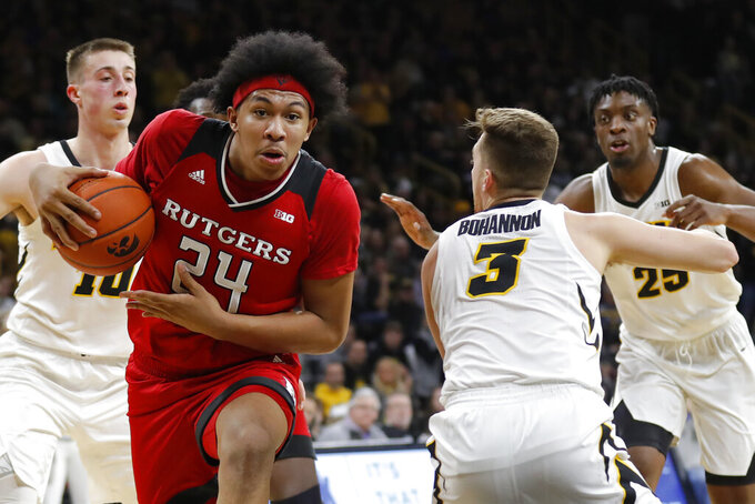 File-This March 2, 2019, file photo shows Rutgers forward Ron Harper Jr. (24) driving to the basket past Iowa guard Jordan Bohannon (3) during the first half of an NCAA college basketball game, in Iowa City, Iowa. The Scarlet Knights have not had a winning season since 2005-06, when they posted a 19-14 record and were selected to play in the NIT. They have had five winning seasons since 1990-91, the last time they made the NCAA Tournament. Now entering his fourth season, Steve Pikiell is the sixth coach attempting to get Rutgers back to the NCAA Tournament.(AP Photo/Charlie Neibergall,File)
