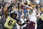Purdue linebacker Jalen Graham (6) moves in on Minnesota quarterback Tanner Morgan (2) during the third quarter of an NCAA college football game, Saturday, Oct. 2, 2021 at Ross-Ade Stadium in West Lafayette, Ind. (Nikos Frazier/Journal & Courier via AP)