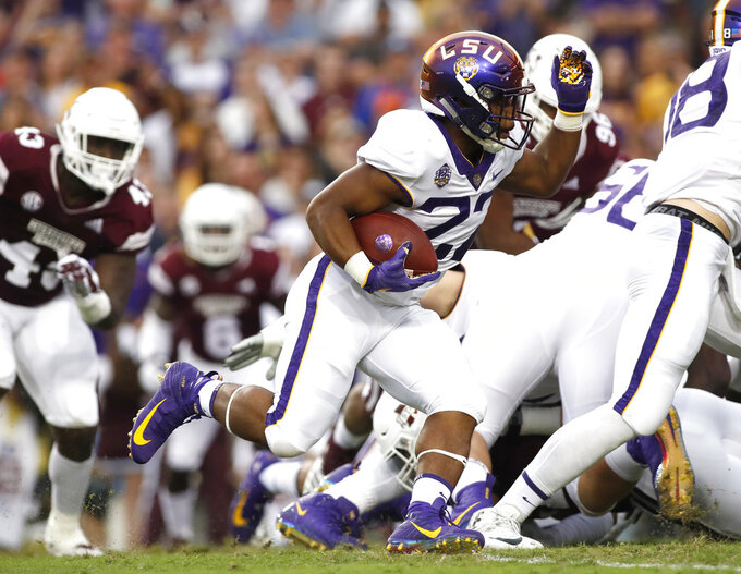 LSU running back Clyde Edwards-Helaire (22) runs the ball during an NCAA college football game against Mississippi State in Baton Rouge, La., Saturday, Oct. 20, 2018. (AP Photo/Tyler Kaufman)