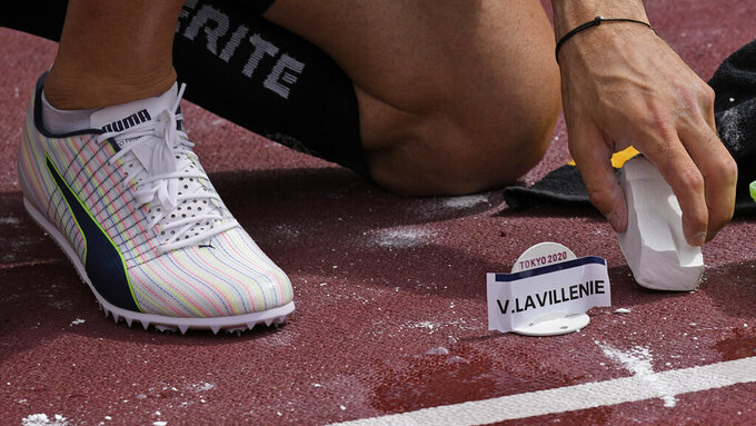 Valentin Lavillenie, of France, marks the track ahead of the qualification round of the men's pole vault at the 2020 Summer Olympics, Saturday, July 31, 2021, in Tokyo. (AP Photo/David J. Phillip)