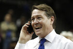 Saint Louis head coach Travis Ford talks on the phone moments after defeating St. Bonaventure during an NCAA college basketball final game in the Atlantic 10 men's tournament, Sunday, March 17, 2019, in New York. (AP Photo/Julio Cortez)