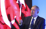 Turkey's Defense Minister Hulusi Akar addresses a meeting of his country's ambassadors, in Ankara, Turkey, Wednesday, Aug. 7, 2019.  Akar says his country would like to establish a safe zone in northeast Syria jointly with the United States but would act alone if necessary. (Turkish Defence Ministry via AP, Pool)