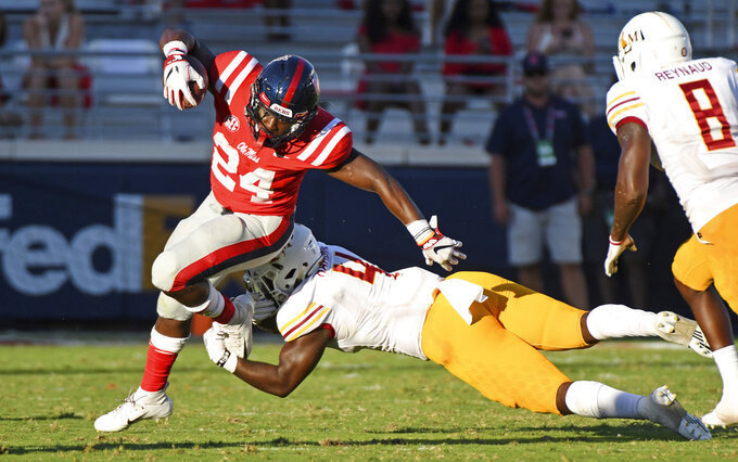 Mississippi running back Eric Swinney (24) looks for room past Louisiana Monroe linebacker Rashaad Harding (4) during the second half of an NCAA college football game in Oxford, Miss., Saturday, Oct. 6, 2018. Mississippi won 70-21. (AP Photo/Thomas Graning)