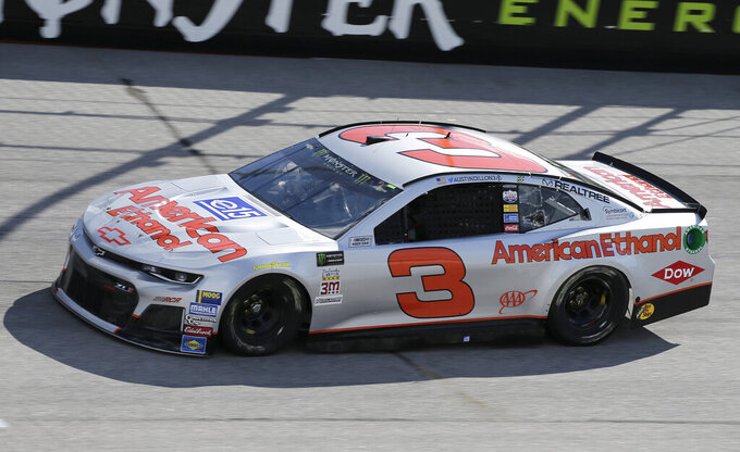 FILE - In this Aug. 31, 2018, file photo, Austin Dillon drives a car painted with a throwback scheme from the Dale Earnhardt era into Turn 1 during a NASCAR Cup Series auto racing practice session at Darlington Raceway, in Darlington, S.C.   (AP Photo/Terry Renna)