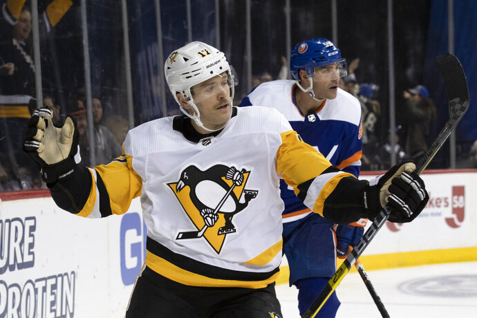 Pittsburgh Penguins right wing Bryan Rust celebrates after scoring a goal against the New York Islanders during the third period of an NHL hockey game, Thursday, Nov. 7, 2019, in New York. The Penguins won 4-3. (AP Photo/Mary Altaffer)