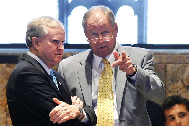 FILE - In this June 4, 2012, file photo, state Sen. Conrad Appel, left, R-Metairie, and state Rep. Steve Carter, R-Baton Rouge, confer at the side of the House Chamber during the debate on Appel's Senate Concurrent Resolution 99, a $3.4 billion dollar spending plan for public schools, on the closing day of the 2012 legislative session at the state Capitol in Baton Rouge, La. Former Louisiana lawmaker Steve Carter, a Baton Rouge Republican who championed school choice issues during his three terms in the state House and spoke strongly in favor of following health guidelines to stop the spread of the coronavirus, died Tuesday, Jan. 26, 2021, of complications from COVID-19. He was 77. (Travis Spradling/The Advocate via AP)