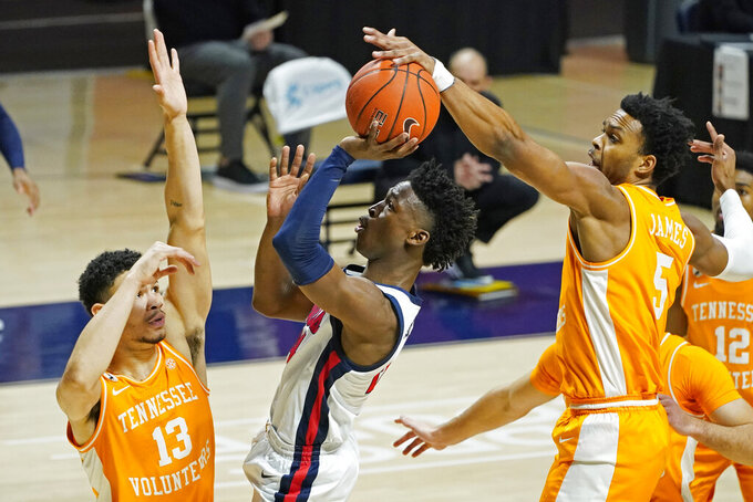 Mississippi guard Jarkel Joiner (24) has his shot blocked by Tennessee guard Josiah-Jordan James (5) and forward Olivier Nkamhoua (13) during the first half of an NCAA college basketball game in Oxford, Miss., Tuesday, Feb. 2, 2021. (AP Photo/Rogelio V. Solis)