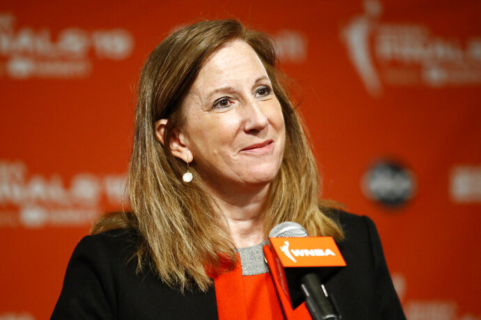FILE - In this Sept. 29, 2019, file photo, WNBA Commissioner Cathy Engelbert speaks at a news conference in Washington.  The WNBA and its union announced a tentative eight-year labor deal Tuesday, Jan. 14, 2020,  that will allow top players to earn more than $500,000 while the average annual compensation for players will surpass six figures for the first time. I call it historic,