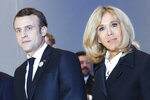 France's President Emmanuel Macron and his wife Brigitte Macron pose during the 34rd annual dinner of the group CRIF, Representative Council of Jewish Institutions of France, in Paris, Wednesday, Feb. 20, 2019. (AP Photo/Thibault Camus)